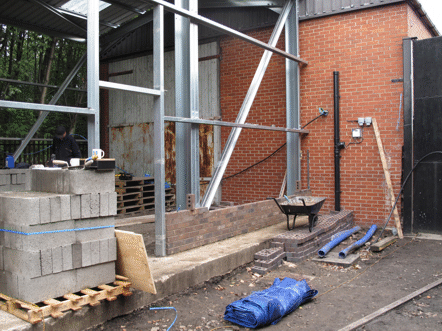first few courses of bricks laid