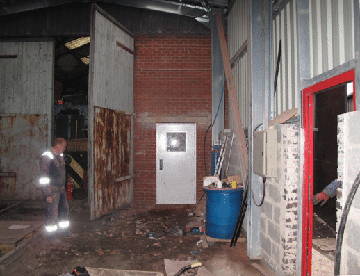 door into the old workshop in place