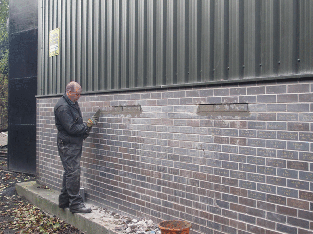 laying the corrected bricks
