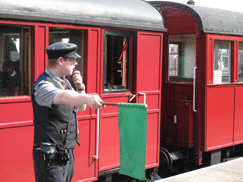 The guard setting a train off