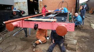 volunteers overhauling a goods wagon